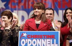 Republican Christine O'Donnell, surrounded by family and supporters, delivers remarks after conceding the election to opponent Democrat Chris Coons, Nov. 2, in Dover, Del.