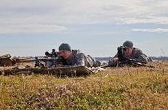 Snipers train with XM2010 Enhanced Sniper Rifle at a facility in Arkansas. The rifle has a more powerful telescope and a device on the muzzle that dampens the noise and flash of a shot.