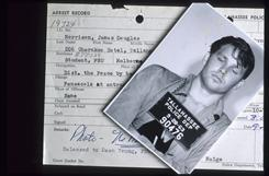 This archive photo shows the mug  shot and arrest record of singer Jim Morrison from an incident following a football game at Florida State University in 1963. The state pardoned Morrison on Thursday on an indecent exposure charge stemming from a concert in 1969.