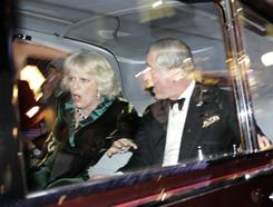 "Britain's Prince Charles and Camilla, Duchess of Cornwall, react as their car is attacked by angry protesters in London on Thursday. Charles' office confirmed the attack, but said but ""their royal highnesses are unharmed."""