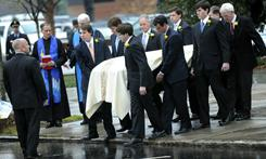 Elizabeth Edwards' casket is carried out of the Edenton Street United Methodist Church on Dec. 11 in Raleigh, N.C. Edwards died Tuesday after a six-year battle with breast cancer at age 61.