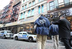 Members of the New York Police Department Crime Scene Unit arrive at an apartment in the Soho neighborhood of New York where the body of Mark Madoff, son of Bernard Madoff, was found Saturday.