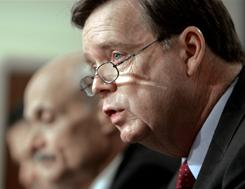 Assistant Defense Secretary Paul McHale, right, speaks during a press briefing at the Eisenhower Executive Office Building. McHale proposed cutting the size of the House to 295 members in 1995.