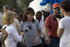 Former Alaska governor Sarah Palin, center, is interviewed during her visit to a cholera treatment center run by Rev. Franklin Graham's relief organization on Saturday.