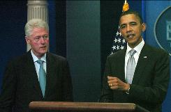Former president Bill Clinton, left, voiced his support for President Obama's tax cut deal at an impromptu news conference in the White House on Dec. 10.