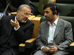 Iranian President Mahmoud Ahmadinejad, right, listens to his Foreign Minister Manouchehr Mottaki, during a meeting in Tehran in 2008. Ahmadinejad fired Mottaki on Monday.