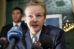 WikiLeaks founder Julian Assange speaks during a news conference at the Geneva press club, in Geneva, Switzerland. Assange is to meet British police to discuss a European extradition warrant from Sweden regarding alleged sexual assaults.