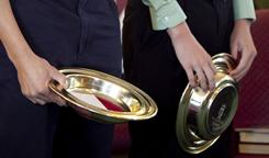 File photo of church collection plates in Chambersburgh, Pa., last year. Downtown in giving is hitting smaller congregations hard.
