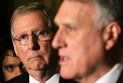Senate Minority Leader Mitch McConnell, R-Ky., listens as Sen. Jon Kyl, R-Ariz., speaks Tuesday to reporters.
