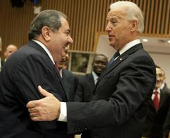 Vice President Biden, right, embraces Iraq's Foreign Minister Hoshyar Zebari on Wednesday during a High Level meeting in the United Nations Security Council in New York. The U.N. Security Council lifted sanctions that barred Iraq from acquiring weapons of mass destruction and pursuing a civilian nuclear program,