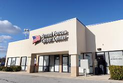 Two young men peer inside the Armed Forces Career Center, which was closed, in Catonsville, Md. on Dec. 8. A Baltimore man was charged with trying to detonate what he thought was a bomb at this military recruitment center.