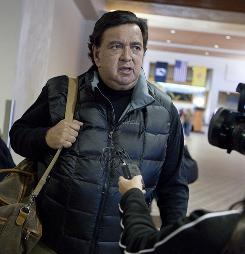 New Mexico Gov. Bill Richardson talks with a reporter at the Albuquerque airport on his way to North Korea on Tuesday.