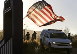 A U.S. Border Patrol truck blocks the road leading to a search area near where agent Brian Terry was killed northwest of Nogales, Ariz., on Wednesday.