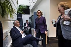 Speaker of the House Nancy Pelosi, center, chats with Democratic representatives after a caucus where members discussed the House's up-coming vote on the $858 billion tax-cut bill.