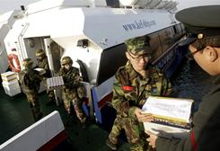 South Korean marines unload their supplies from a ferry at a port in Yeonpyeong island Saturday.