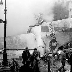 Authorities surround the remains of a United jet in Brooklyn after it collided with a TWA plane above New York City on Dec. 16, 1960.