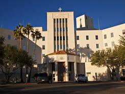 St. Joseph's Hospital's Catholic status is in debate after the hospital's decision last fall to terminate a pregnancy that posed serious health risks to the mother.