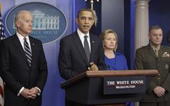 President Obama stands with, from left, Vice President Biden, Secretary of State Hillary Rodham Clinton, and Joint Chiefs Vice Chairman Marine Gen. James Cartwright, as he speaks about the Afghanistan-Pakistan Annual Review on Thursday at the White House.