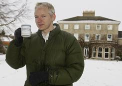 Julian Assange head of WikiLeaks takes a drink during a press conference at the home of Frontline Club founding member Vaughan Smith, at Bungay, England, on Friday.