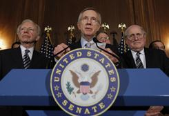"""Senate Majority Leader Sen. Harry Reid, D-Nev., center, with Sen. Joe Lieberman, I-Conn., left, and Sen. Carl Levin, D-Mich., speaks at a news conference about the """"Don't Ask Don't Tell"""" bill during an unusual Saturday session on Capitol Hill on Saturday."""