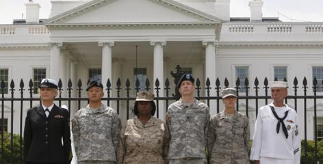 Petty Officer Autumn Sandeen, Lt. Dan Choi, Cpl. Evelyn Thomas, Capt. Jim Pietrangelo II, Cadet Mara Boyd and Petty Officer Larry Whitt stand together after they handcuffed themselves to the fence outside the White House in April during a protest for gay rights.
