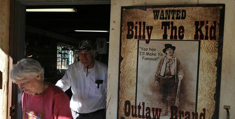 Doris and John Jenkins of Arizona exit a Billy the Kid gift shop in Lincoln, N.M., in October.