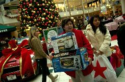 "Customers carry boxes of appliances on ""Black Friday""  the Friday after Thanksgiving  at the Fashion Centre at Pentagon City in Arlington, Va."