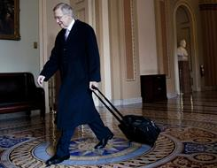 Senate Majority Leader Harry Reid arrives Sunday on Capitol Hill for a work session.