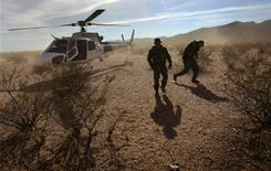 Border Patrol agents deplane Dec. 9 on Tohono O'odham Reservation in Arizona looking for drug smugglers.