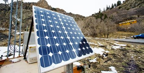 A mobile solar-powered camera and weather station stand along a road in Big Cottonwood Canyon near Salt Lake City. The station includes a camera to send out images of traffic and weather.