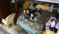 Jobless since June, Brian and Salena Smith currently live in the garage of Salena's mother with their two children, Isabella, 4, and Nathaniel, 2, and what possessions they could fit.
