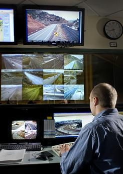 Jeff Williams monitors rural road cameras --  some of them solar-powered --  at Utah's Traffic Operation Center in Salt Lake City.