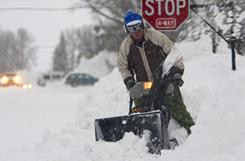 Jeff Graceffa clears snow from in front of his Crested Butte, Colo., home Monday. A major snowstorm blasted Crested Butte with several feet of snow in three days.