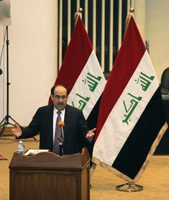 Iraq's Prime Minister Nouri al-Maliki speaks to lawmakers during a parliament session in Baghdad on Tuesday. Iraqi lawmakers unanimously approved  a new government to be headed by incumbent al-Maliki, ending nine months of deadlock that threatened to stall development and suck the country back into sectarian violence.