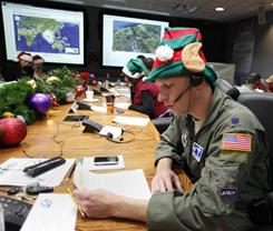 Volunteers at NORAD, such as Air Force Lt. Col. David Hanson, take as many as 80,000 phone calls from youngsters and adults around the world with questions about Santa and his travels.