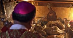 Latin Patriarch of Jerusalem Fouad Twal blesses the statue of the baby Jesus inside the grotto where Christians believe Jesus was born in Bethlehem, early Saturday.