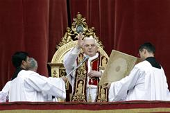 """Pope Benedict XVI blesses the faithful during the """"Urbi et Orbi"""" message in St. Peter's square at the Vatican on Dec. 25. In his Christmas message, he urged Catholics in China to courageously face limits on religious freedom and conscience."""