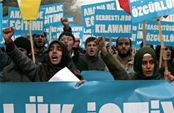 Pro-Kurdish and pro-Islamic students shout slogans against the ban on Islamic-style head scarves and the ban on teaching the Kurdish language atTurkish universities during a protest in Ankara on Dec. 25.
