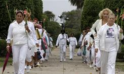 Laura Pollan, leader of the Cuban dissident group Ladies in White, front right, demonstrates during the group's weekly march in Havana, Cuba, on Sunday. The 'Ladies in White' is an organization created by wives and mothers of Cuban political prisoners.