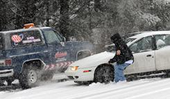 A man tries unsuccessfully to keep his car from sliding into another vehicle near in Asheville, N.C. on Saturday. North Carloina and other Southern states made emergency declarations as the storm caused crashes on slick roads.