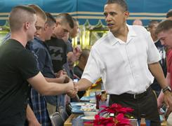President Obama greets members of the U.S. military and their families as they eat a Christmas Day meal at Marine Corps Base Hawaii at Kaneohe Bay, Hawaii.
