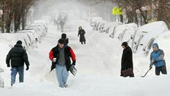 People walk through the snow in Manhattan's East Village Monday in New York City.