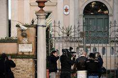 Cameramen and journalits stand in front of Finland's embassy to the Vatican on Monday in Rome, after a suspect package has been found and declared a false alarm. A parcel bomb was intercepted and defused earlier at the Greek embassy in Rome. Italian investigators said an attempted parcel bombing at the Greek embassy in Rome bore the hallmarks of a similar attack by an anarchist group at the Chilean and Swiss missions last week.