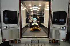 Gig Harbor Fire & Medic One firefighter Josh Bissenas, right, and EMT paramedic Gary Battaglia perform a routine daily equipment check in their ambulance at Swede Hill Station 58 in Gig Harbor, Wash.