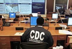 A worker at the Centers for Disease Control and Prevention sits at a station in the emergency operations center as the CDC monitors swine flu development in this April 27, 2009, file photo taken in Atlanta. The U.S. Centers for Disease Control and Prevention lost or misplaced more than $8 million in property in 2007, auditors say.