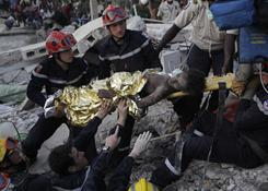 In this Jan. 27 photo, French search and rescue workers pull a girl from the rubble of College St. Gerard 15 days after an earthquake in Port-au-Prince.