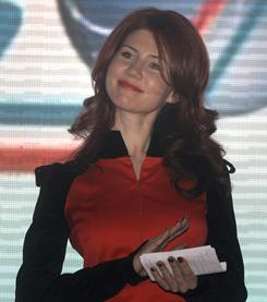 Anna Chapman, who was deported from U.S. on charges of espionage, on stage with the leaders of Young Guards, a pro-Kremlin youth movement she joined, in Moscow on Dec. 22, 2010.