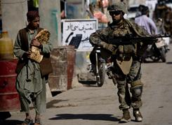 Marine Lance Cpl. Andreas Padilla walks through a market in November in dangerous Sangin, Afghanistan, a Taliban pocket of resistance.