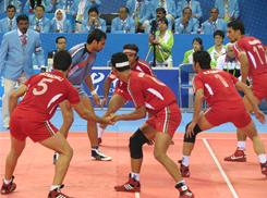 An Indian raider (light blue) enters the Iranian end of the court in the Kabbadi competition at the Asian Games in Guangzhou, China, on Nov. 23. Derived from Indian military training centuries ago, the aim of Kabbadi is to score points by touching as many defensive players as possible without getting captured.