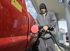 A customer pumps gas at a Chevron gas station with a gas price of $3.55 a gallon in San Francisco on Nov. 23. Drivers in the USA could be paying as much as $3.75 a gallon for gas this spring, oil experts predict.